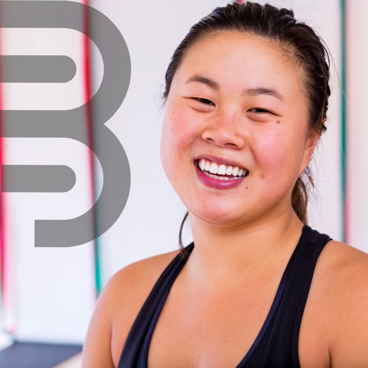 woman smiling at BOARD30 fitness studio