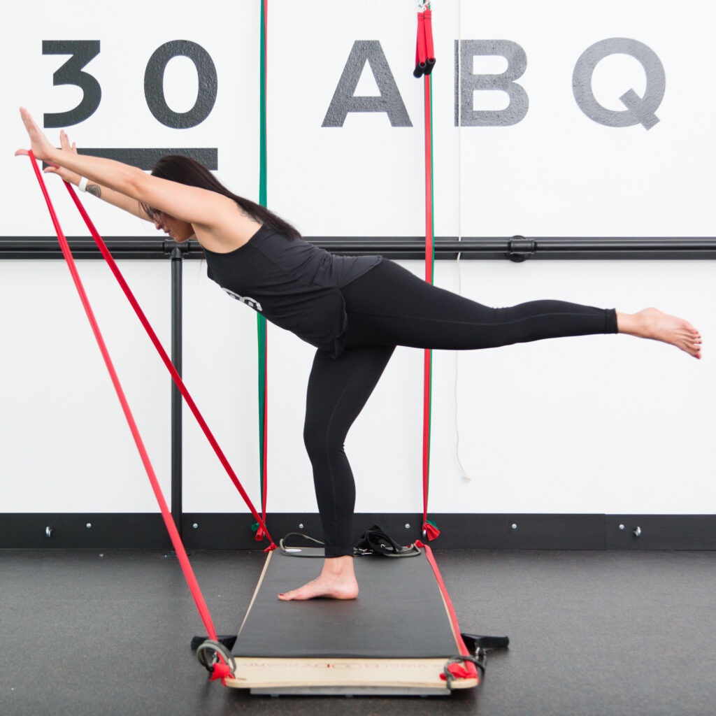 woman using the BOARD30 system during a HIIT workout at BOARD30 ABQ
